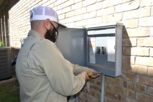 An Electrician Working on A Service Panel